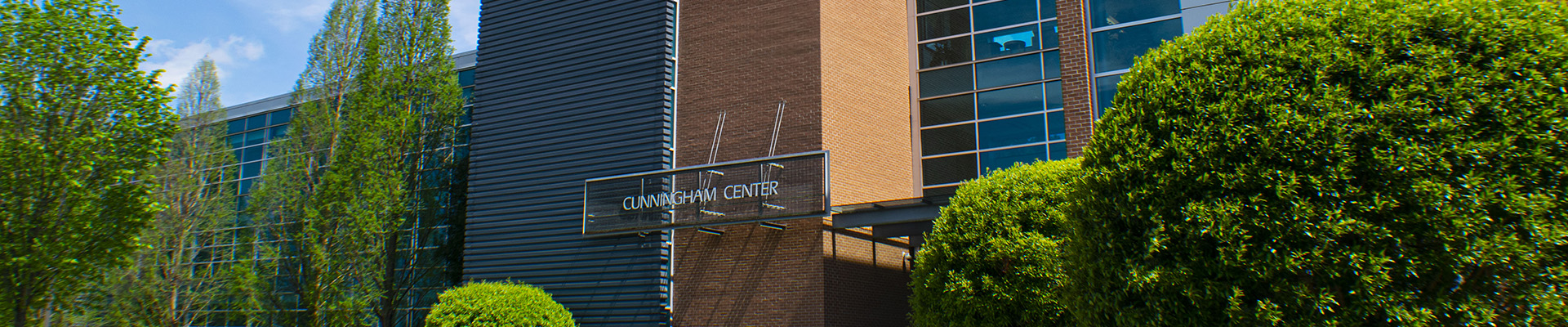 a large building with the words Cunningham Center on it